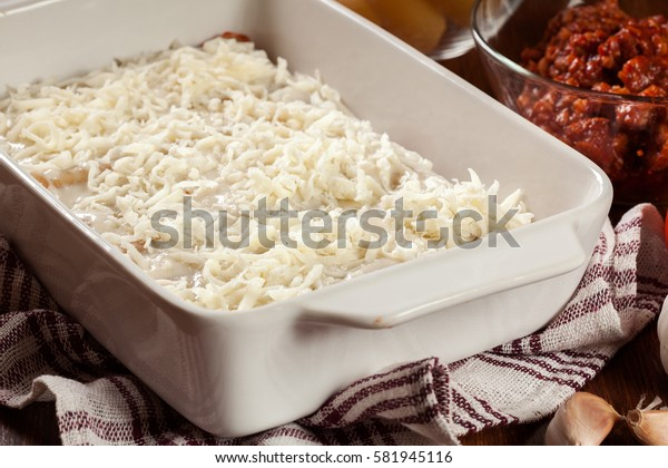 Cannelloni stuffed with meat cooked in a casserole dish ready for baking. Italian cuisine