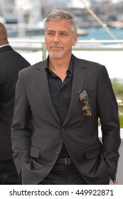 """CANNES, FR - MAY 12, 2016: Actor George Clooney at the photocall for """"Money Monster"""" at the 69th Festival de Cannes."""
