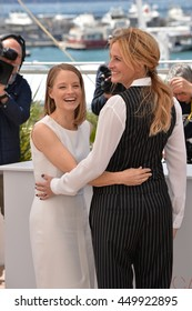 "CANNES, FR - MAY 12, 2016: Actress/director Jodie Foster & actress Julia Roberts at the photocall for ""Money Monster"" at the 69th Festival de Cannes."