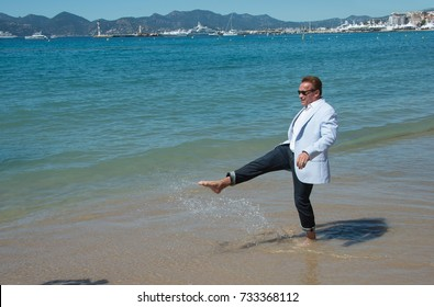 """CANNES, FR - May 20, 2017: Arnold Schwarzenegger at the photocall for """"Wonders of the Sea 3D"""" on the beach at the 70th Festival de Cannes"""