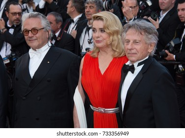 CANNES, FR - May 23, 2017: George Martin, Catherine Deneuve & Roman Polanski at the 70th Anniversary Gala for the Festival de Cannes