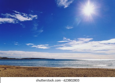 CANNES, FRANCE - 11 February, 2016: The famous Croisette's beach on a bright sunny winter day, with view over the Lerins Islands and the horizon