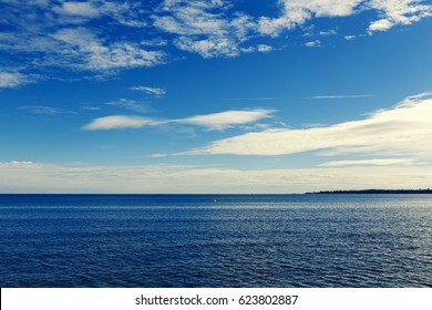 CANNES, FRANCE - 11 February, 2016: Mediterranean sea view from Cannes at dusk, with the Lerins Islands in the distance