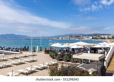 CANNES, FRANCE- APRIL 15: Beach restaurant with beautiful city landmark on April 15, 2016 in CANNES, Cannes is a city located on the French Riviera and host city of the annual Film frstival