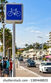 CANNES, FRANCE - APRIL 2019: Sign above a cycle lane alongside a road on the promenade in Cannes