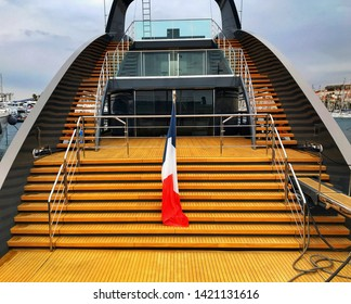 "CANNES, FRANCE - APRIL 2019: Wooden decking and steps on the sleek superyacht ""Ocean Sapphire"" in Cannes"