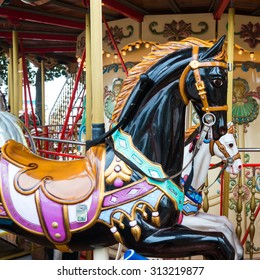 CANNES, FRANCE - AUGUST 01,2015: Vintage merry-go-round with horses and other animals for kids at Croisette promenade on August 01,2015 in Cannes, France.