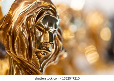 Cannes, France - February 28, 2019: Closed up of gold Cannes lion award, trophy for winner of advertising agency in yearly festival in Cannes, France.