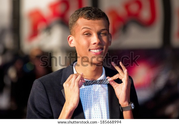 CANNES, FRANCE - JANUARY 22, 2011 - Stromae on the red carpet of NRJ Music Award 2011 during the Midem (music industry trade fair)