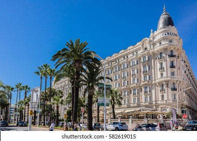 "CANNES, FRANCE - JULY 10, 2014: Luxury hotel ""Inter Continental Carlton"" (343 rooms, built in 1911), located on the famous ""La Croisette"" Boulevard in Cannes, French Riviera."