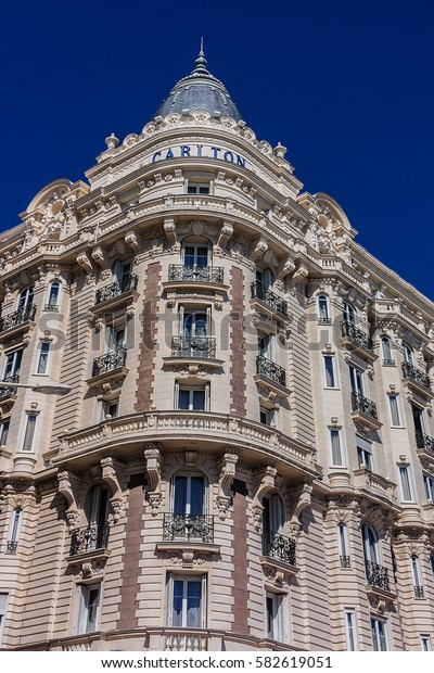 """CANNES, FRANCE - JULY 10, 2014: Luxury hotel """"Inter Continental Carlton"""" (343 rooms, built in 1911), located on the famous """"La Croisette"""" Boulevard in Cannes, French Riviera."""