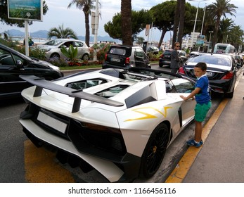 CANNES FRANCE - JULY 25, 2016:  Interest of the boy to the Lamborghini supercar