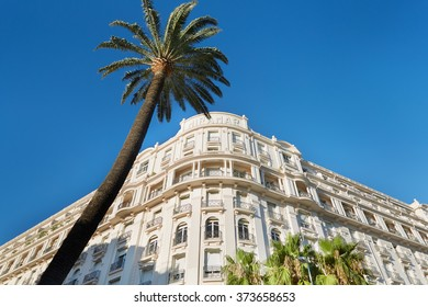 """CANNES, FRANCE - JULY 27, 2015: Luxury hotel """"Le Palais Miramar"""" (1929), located on famous Croisette boulevard in Cannes, French Riviera. Miramar is one of most famous hotel in Cannes."""
