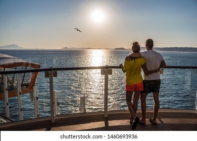 Cannes, France - July 4, 2019: Couple is watching sunset onboard newest cruise ship of Celebrity Cruises. Open deck and view on magic carpet on Edge. Moving platform is revolution in cruise industry.