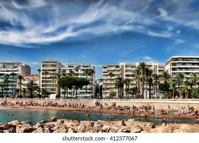 CANNES, FRANCE -  JULY 5, 2015: The beach in Cannes. Cannes located in the French Riviera. The city is famous for its Film Festival. FRANCE, - JULY 5, CANNES 2015