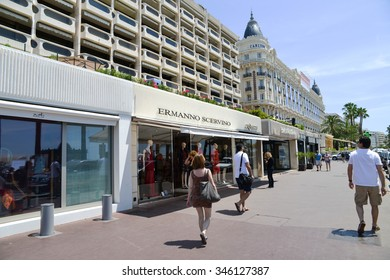 CANNES, FRANCE - JUNE 21, 2015: A general view of Hotel CARLTON CANNES and expensive shops along the Croisette.