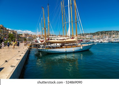 CANNES, FRANCE - JUNE 23, 2016: Yachts anchored in port in Cannes in a beautiful summer day, France on June 23, 2016