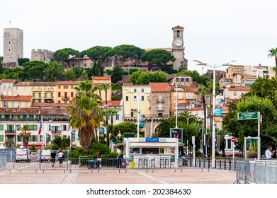 CANNES, FRANCE - JUNE 25, 2014: Achitecture and the clock tower in Cannes. Cannes hosts the annual Cannes Film festival from 1949