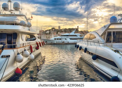 CANNES, FRANCE - MAY 02, 2012: Large luxury yacht in the famous bay, during a beautiful sunset, May 02, 2012 in Cannes, France.