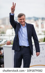 CANNES, FRANCE - MAY 09, 2018: Director Sergey Loznitsa gives the peace sign as he attends the photocall for 'Donbass' during the 71st annual Cannes Film Festival at Palais des Festivals