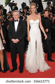 """CANNES, FRANCE - MAY 11, 2011: Robert De Niro & Uma Thurman at the gala premiere for """"Midnight in Paris"""" the opening film at the 64th Festival de Cannes. May 11, 2011  Cannes, France"""