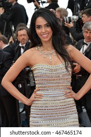 """CANNES, FRANCE - MAY 11, 2016: Actress Mallika Sherawat at the gala premiere of Woody Allen's """"Cafe Society"""" at the 69th Festival de Cannes."""