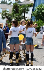 Cannes, France - May 11, 2018:  Grazia employees distributing the magazine to the crowd at the 71st  Cannes Film Festival.