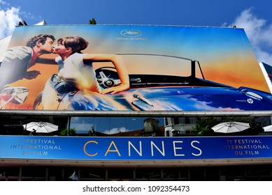 Cannes, France - May 11, 2018:  The poster for the 71st Cannes Film Festival features a scene from the movie Pierrot Le Fou. The photograph was taken by Georges Pierre and reimagined by Flore Maquin