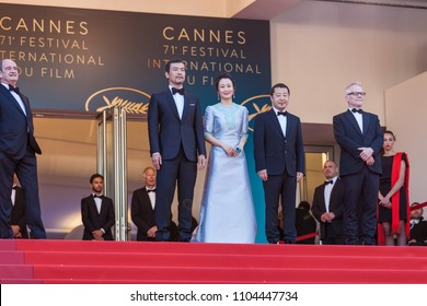 CANNES, FRANCE - MAY 11, 2018: Actors Fan Liao, Zhao Tao and director Zhangke Jia attend the screening of 'Ash Is The Purest White (Jiang Hu Er Nv)' during the 71st annual Cannes Film Festival
