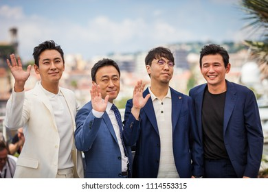 CANNES, FRANCE - MAY 11, 2018: Actor Ji-Hoon Ju, actor Sung-min Lee, director Jong-bin Yoon and actor Jung-min Hwang attend the 'The Spy Gone North (Gongjak)' Photocall on 71 Cannes Film Festival