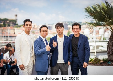 CANNES, FRANCE - MAY 11, 2018: Actor Ji-Hoon Ju, actor Sung-min Lee, director Jong-bin Yoon and actor Jung-min Hwang attend the 'The Spy Gone North (Gongjak)' Photocall on 71st  Cannes Film Festival