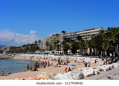 Cannes, France - May 11, 2018:  People enjoy the beach near the Port de Cannes while the film festival takes place in the famous resort town.