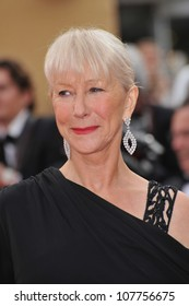 """CANNES, FRANCE - MAY 12, 2010: Dame Helen Mirren  at the premiere of """"Robin Hood"""" the opening film at the 63rd Festival de Cannes."""
