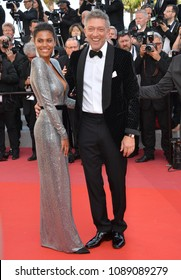 "CANNES, FRANCE. May 12, 2018: Vincent Cassel & Tina Kunakey at the gala screening for ""Girls of the Sun"" at the 71st Festival de Cannes"