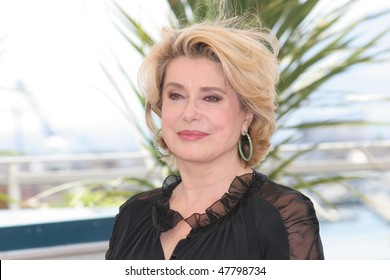CANNES, FRANCE - MAY 12: Catherine Deneuve poses for a picture during a photocall at the 58th International Cannes Film Festival May 12, 2004 in Cannes, France