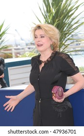 CANNES, FRANCE - MAY 12: Catherine Deneuve poses for a picture during a photocall at the 58th International Cannes Film Festival May 12, 2004 in Cannes, France.