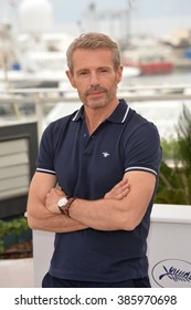 CANNES, FRANCE - MAY 13, 2015: Actor Lambert Wilson at photocall for the Master of Ceremonies at the 68th Festival de Cannes.