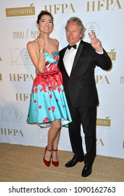 CANNES, FRANCE. May 13, 2018: Blanca Blanco & John Savage at the Hollywood Foreign Press Association Party at Nikki Beach at the 71st Festival de Cannes