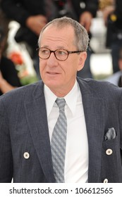 """CANNES, FRANCE - MAY 14, 2011: Geoffrey Rush at the photocall for his movie """"Pirates of the Caribbean: On Stranger Tides"""" at the 64th Festival de Cannes. May 14, 2011  Cannes, France"""
