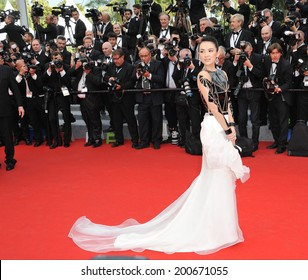 """CANNES, FRANCE - MAY 14, 2014: Zhang Ziyi at the gala premiere of """"Grace of Monaco"""" at the 67th Festival de Cannes."""