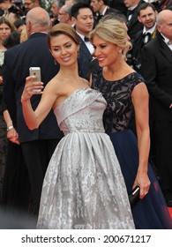 """CANNES, FRANCE - MAY 14, 2014: Hofit Golan & Victoria Bonya (left) at the gala premiere of """"Grace of Monaco"""" at the 67th Festival de Cannes."""