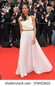 """CANNES, FRANCE - MAY 14, 2014: Zoe Saldana at the gala premiere of """"Grace of Monaco"""" at the 67th Festival de Cannes."""