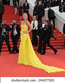 """CANNES, FRANCE - MAY 14, 2015: Charlize Theron at the gala premiere of her movie """"Mad Max: Fury Road"""" at the 68th Festival de Cannes."""