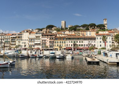 """CANNES, FRANCE - MAY 14, 2016: View of Le Suquet (or Mont-Chevalier) - oldest district of Cannes, """"Old town"""", located on a hill west of bay, above the Port Le Vieux. Cote d'Azur, France."""