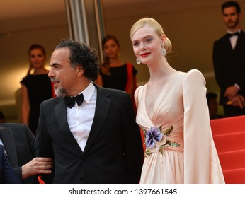 "CANNES, FRANCE. May 14, 2019: Alejandro Gonzalez Inarritu & Elle Fanning at the gala premiere for ""The Dead Don't Die"" at the Festival de Cannes.