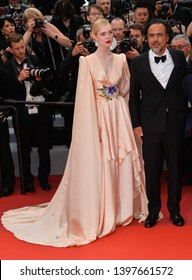 "CANNES, FRANCE. May 14, 2019: Elle Fanning & Alejandro Gonzalez Inarritu at the gala premiere for ""The Dead Don't Die"" at the Festival de Cannes.