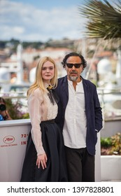 CANNES, FRANCE - MAY 14, 2019:  Elle Fanning and Alejandro Gonzalez Inarritu attend the Jury photocall during the 72nd annual Cannes Film Festival