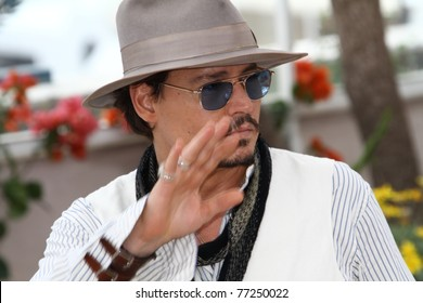 CANNES, FRANCE - MAY 14: Johnny Depp attends the 'Pirates of the Caribbean: On Stranger Tides' photocall at the Palais des Festivals during the 64th Cannes  Festival on May 14, 2011 in Cannes, France.