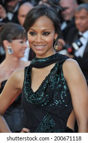 """CANNES, FRANCE - MAY 15, 2014: Zoe Saldana at the premiere of """"Mr. Turner"""" at the 67th Festival de Cannes."""