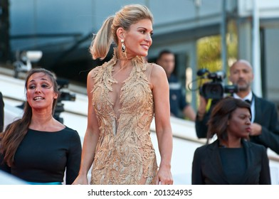 CANNES, FRANCE - MAY 15, 2014: Socialite Hofit Golan walks down the red carpet during the 67th Annual Cannes Film Festival on May 15, 2014 in Cannes, France.